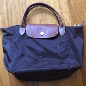 Long champ small handle bag